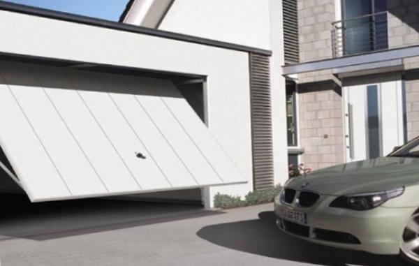 Виды гаражных ворот и способы установки своими руками